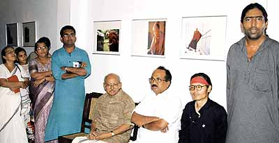 Yesudasan with Honorable Minister for Kerala State Prof KV Thomas, Tenzin Tsundue, Tibetan poet and Anoop Scaria during the 'Ocean of Wisdom' photo exhibition on the Dalai Lama at Kashi Art Café, Fort Cochin on April 17, 2004.