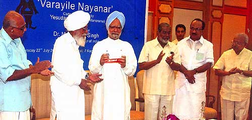 Honourable Prime Minster of India, Dr Manmohan Singh releases Yesudasan's 'Varayile Nayanar' at a function held at the Prime Minister's Office in New Delhi on July 22, 2004. Former Chief Minister of Kerala Shri PK Vasudevan Nair, Shri Surjeet Singh, Union Minister for Power Shri PM Sayeed, Prof KV Thomas and Yesudasan next to him.