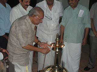 Yesudasan lights a lamp during the Cartoon Camp at Thekkady, Kerala on December 17, 2007. Cartoonist Monai, Sudheernath, Toms and Honourable Forest Minister for Kerala Shri Binoy Biswam next to him.