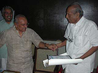 Yesudasan with Cartoonist Toms during a Cartoon Camp at Thekkady, Kerala on December 17, 2007.